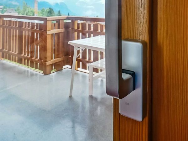 Renovated sliding door to the balcony. Comfort and ergonomic glass system. Laminated profile.